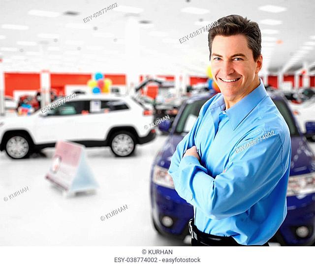 Car dealer man. Auto dealership and rental concept background