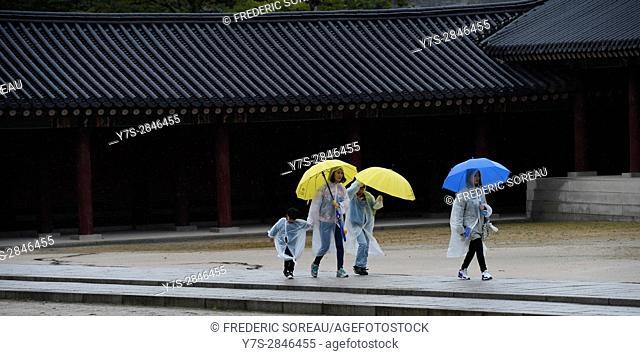 People under umbrella visit Changdeokgung Palace,Seoul,South Korea