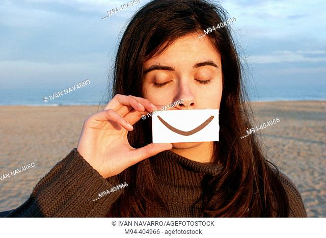 Girl with fake smile and eyes closed