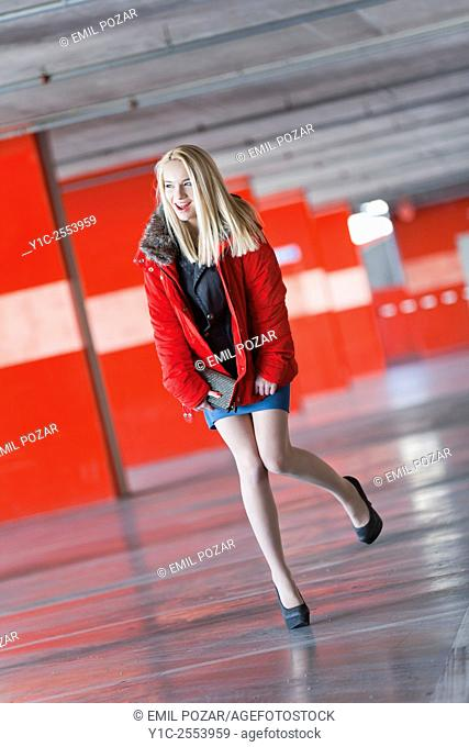 Pretty teen girl in Red jacket excited