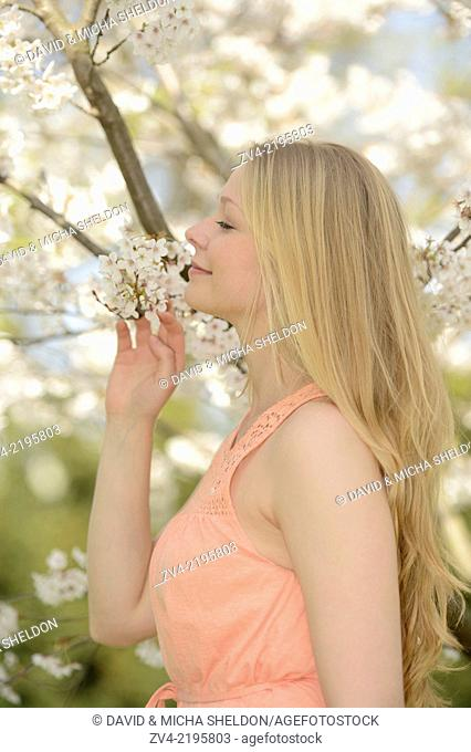Portrait of a young woman in a park in spring