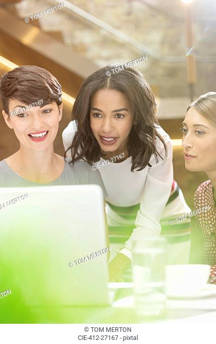 Businesswomen working at laptop in office