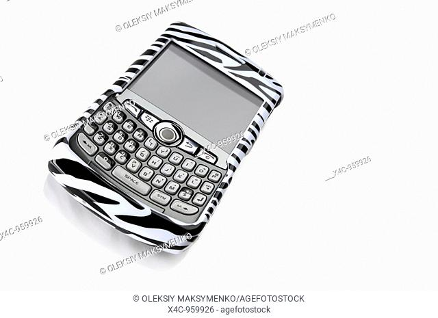 BlackBerry 8310 Curve Smartphone in a fancy stripy zebra cover Isolated on white background