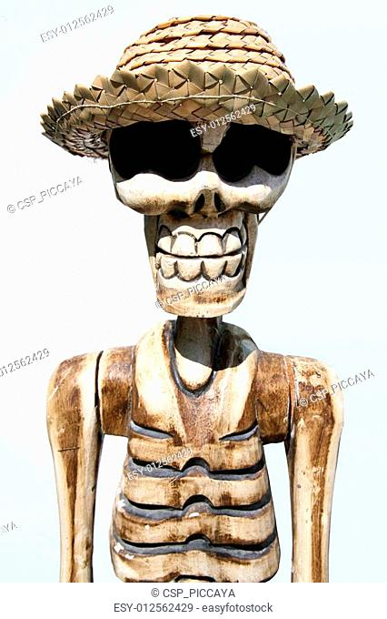 Skeleton wearing a funny hat