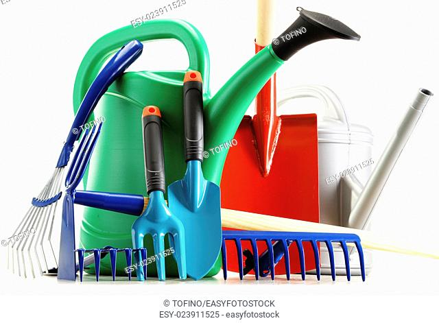 Watering can and garden tools isolated on white background