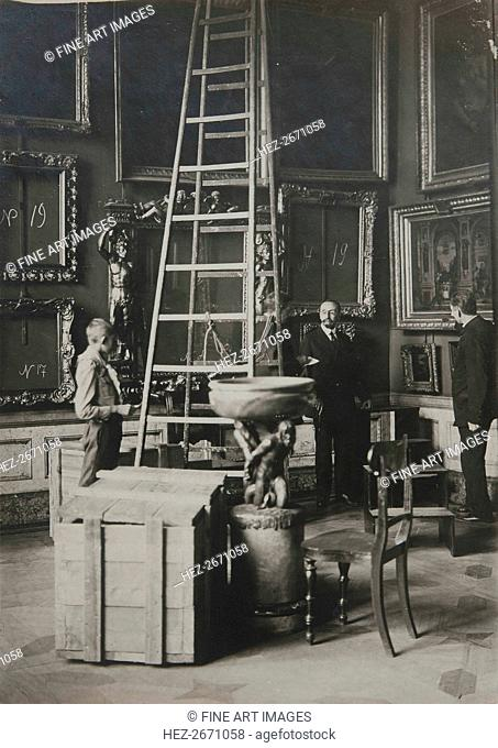 Preparing paintings for evacuation from one of the Italian halls at the Hermitage, 1917
