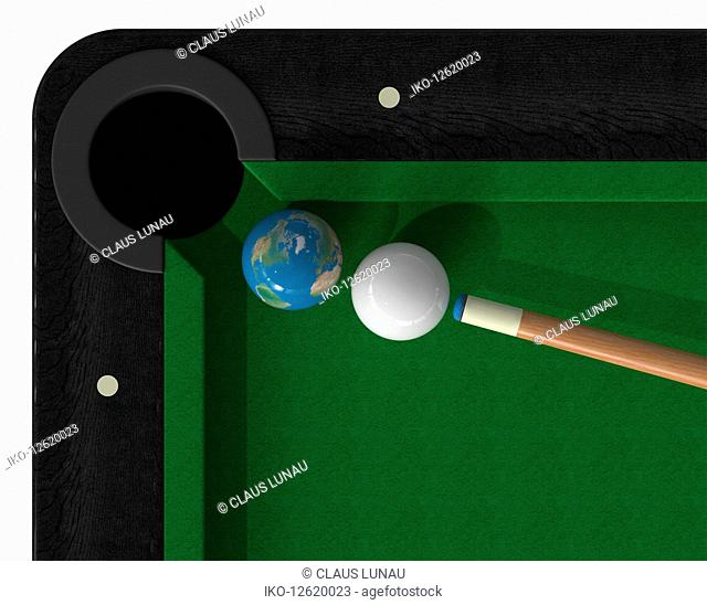 Cue ball about to hit globe ball on snooker table