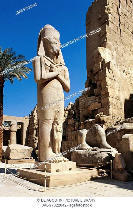 Colossal statue of Ramses II and his wife Nefertari, First Courtyard of the Temple of Amun, Karnak Temple Complex, Luxor, Thebes (Unesco World Heritage List