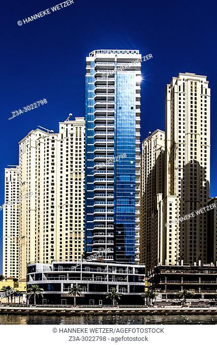 Vew of Dubai Marina promenade with modern towers in Dubai