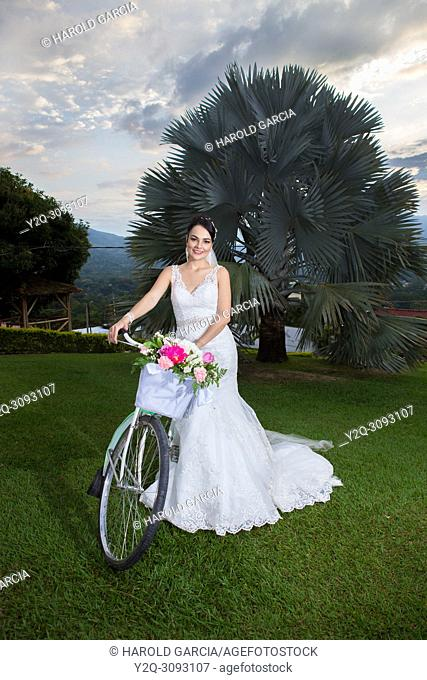 Bride possing with a bike