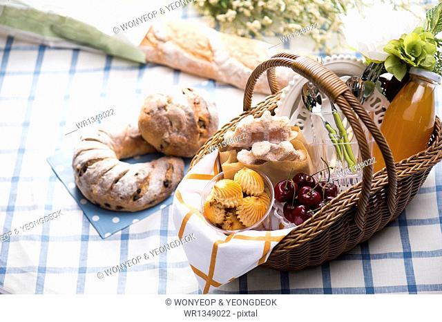 a picnic basket on a sheet