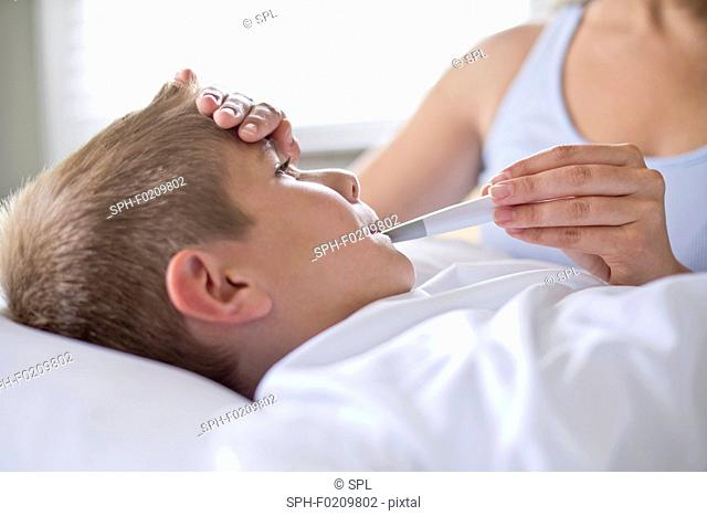 Boy having his temperature taken