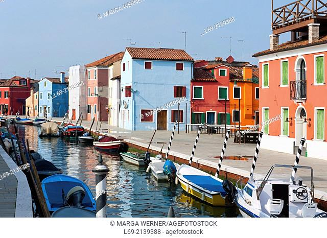 Canal with boats and colorful houses on island Burano, Venice, Italy,