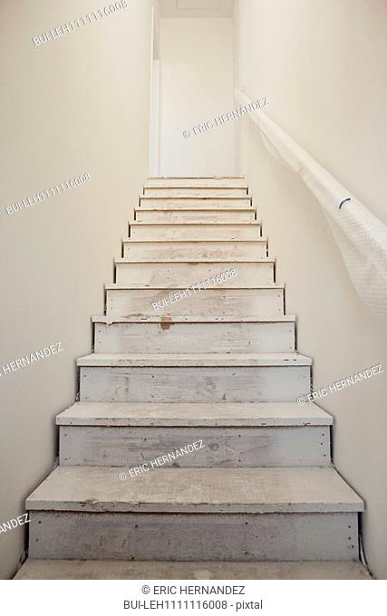 Close-up of white stairs with wall at home