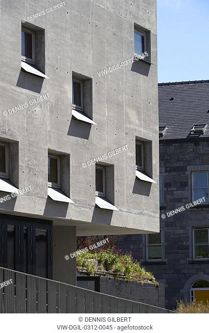 Cast-concrete facade with recessed square windows. Pálás Cinema, Galway, Ireland. Architect: dePaor, 2017
