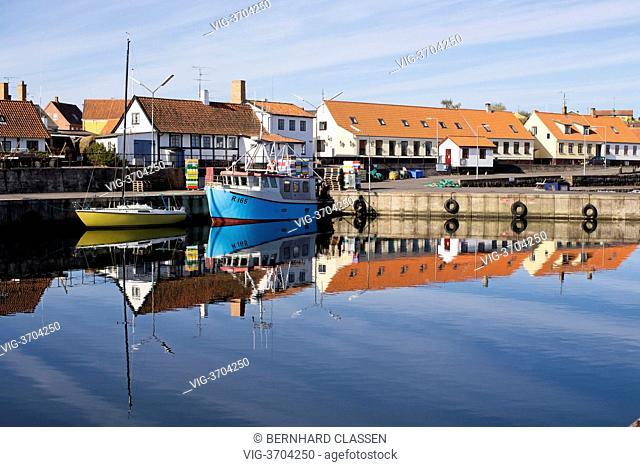 DENMARK, AARSDALE, 12.05.2013, Fishing boat and sailing boat on Bornholm - Aarsdale, Region Hovedstaden, Denmark, 12/05/2013