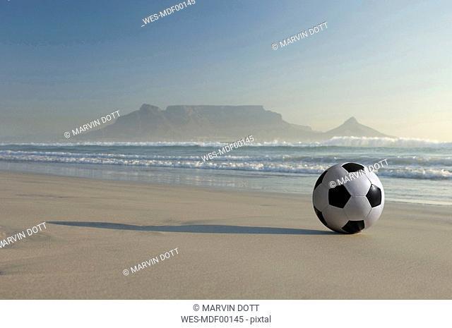 Africa, South Africa, Kapstadt, Soccer ball on beach