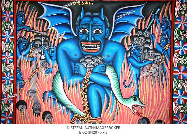 Wall painting blue coloured devil with sinners in the hellfire in the monastery Ukra Kidane Mekret in Tana Lake near Bahir Dar Ethiopia