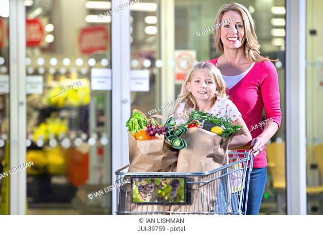 mother, daughter, shopping, groceries, supermarket, trolley