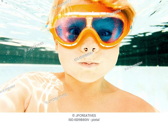 Portrait of young boy in swimming pool, underwater view