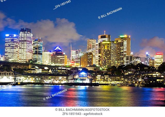 Colorful twilight night shot of colorful skyline of offices in Sydney Australia New South Wales