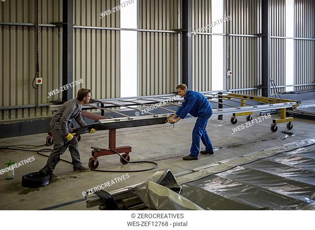 Factory worker in truck manufacture assembling truck parts