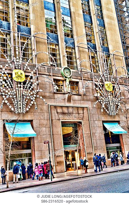 Christmas shoppers and Strollers in front of a Decorated Tiffany's 57th Street, New York City store