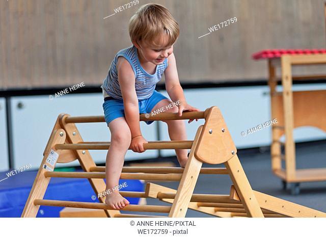 Boy climbing ladder in Gym