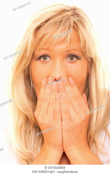 Speak no evil concept. Surprised woman face, covering her mouth with hands isolated