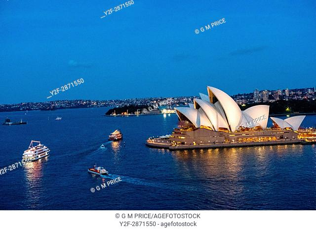 Sydney Harbour at dusk with boats and opera house