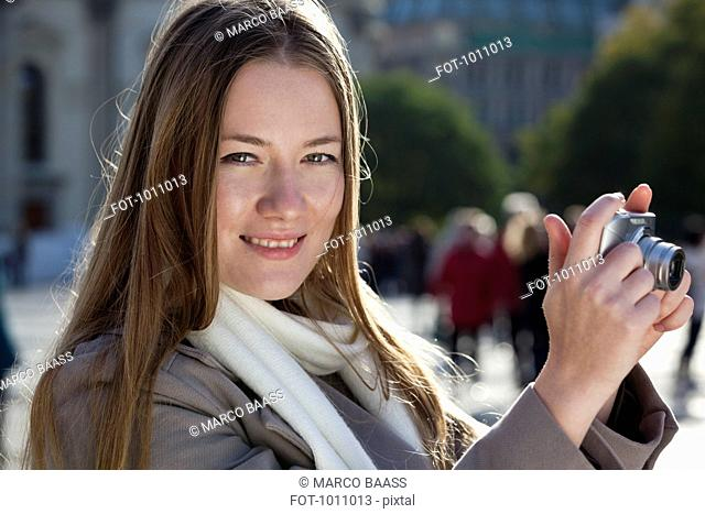 Tourist woman with camera