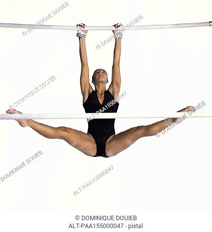 Female gymnast performing on uneven bars