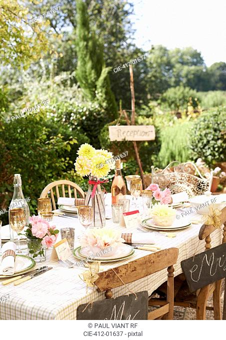 Table set for outdoor wedding reception