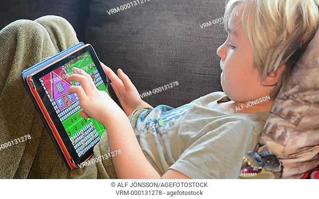 Boy playing with a tablet pc
