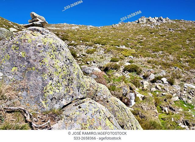 Milestone at Meadows of Centenera. Sierra de Gredos. Mijares. Avila. Castilla Leon. Spain. Europe