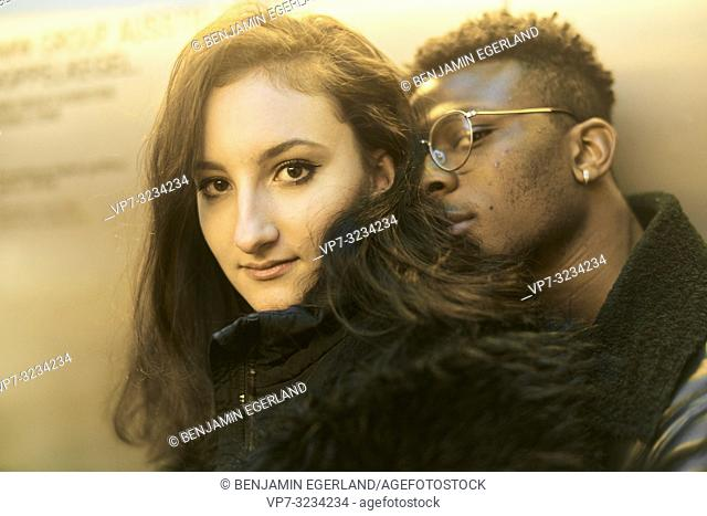 headshot of man leaning head on woman, youth, couple, lovers, relationship, in Munich, Germany