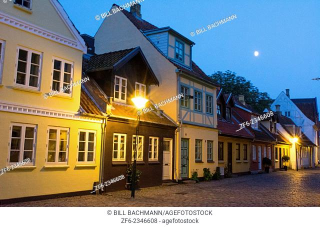 Odense Denmark beautiful old row homes cobblestone streets at twilight siunset night exposure in Hans Christian Andersen birthplace home