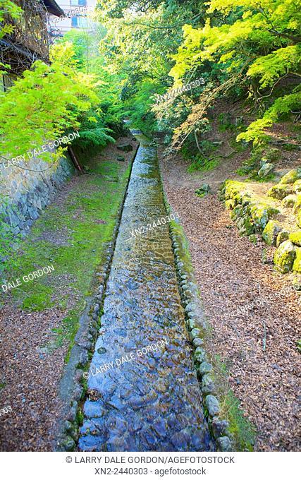 An ancient stone water conduit on Itsukushima Island. Japan