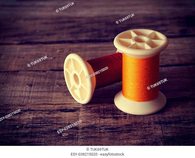 thread rolls on wood background old retro vintage style