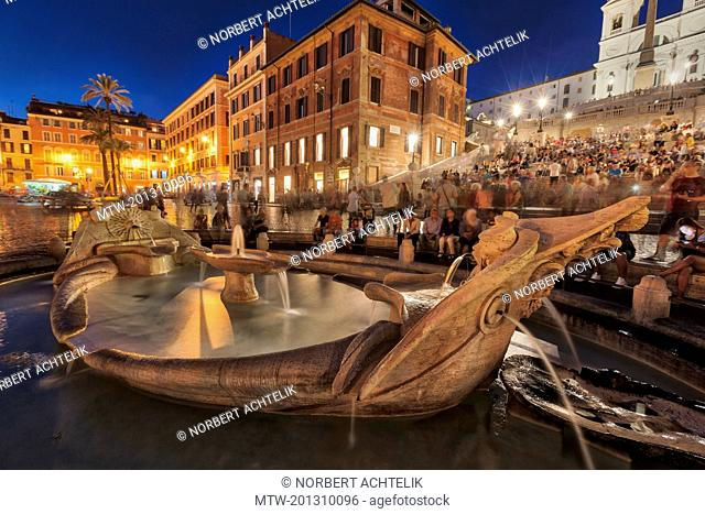 Tourists sitting on Spanish Steps at fountain, Piazza di Spagna, Rome, Italy