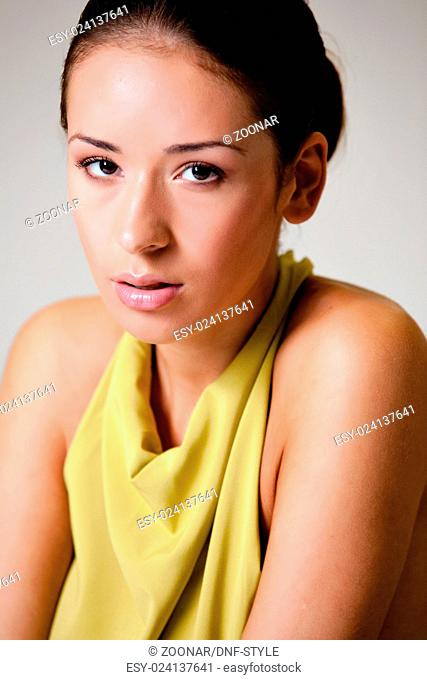 High fashion girl in green dress timide