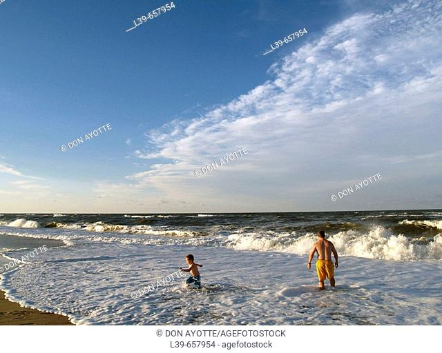 Father & Son playing in the waves in Kill Devil Hills, NC, USA