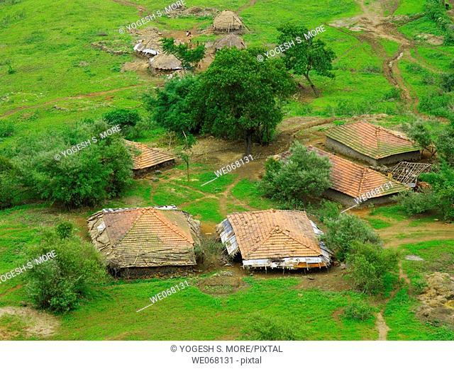 Small huts with sloping roof made of manglori tiles and agricultural land at rural area near Nilkantheshwar, Donje, Pune, Maharashtra, India