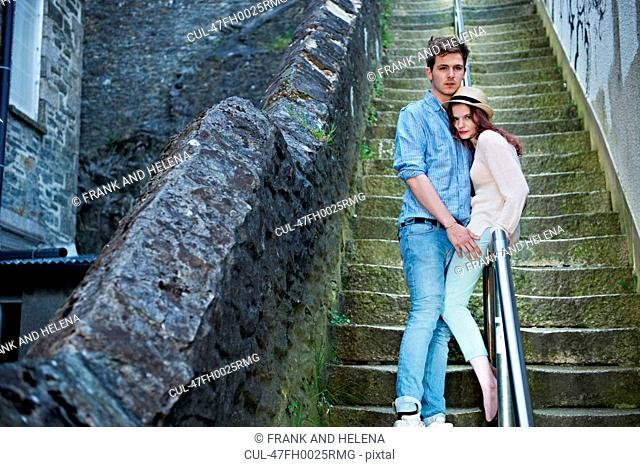 Couple standing on urban steps