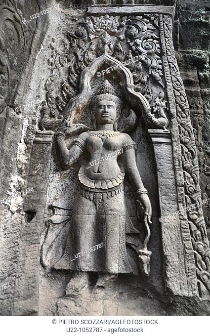 Angkor (Cambodia): apsara relief at the Ta Prohm