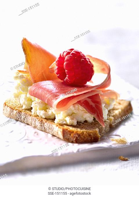Brousse,raw ham and raspberry on toast