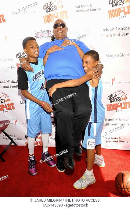 Stevland Morris aka Stevie Wonder gets lifted up by his sons Kailand Morris (l) and Mandla Morris (r) at the 3rd Annual Kailand Obasi Hoop-Life at the Galen...