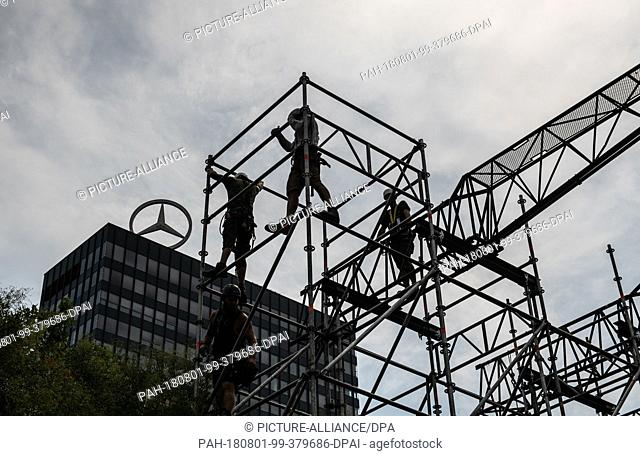 01 Augusut 2018, Germany, Berlin: Workers erect a grandstand for the European Athletics Championships (06.08.2018 - 12.08