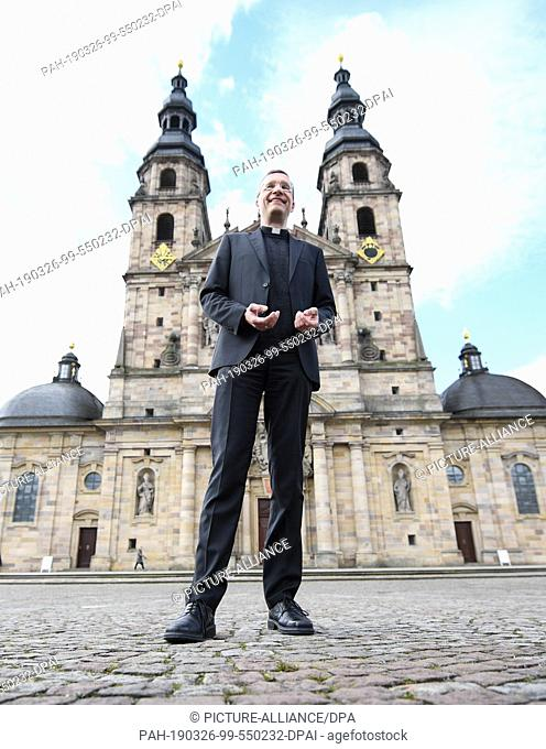 26 March 2019, Hessen, Fulda: Following a press conference, the future bishop of Fulda, Michael Gerber, stands in front of St