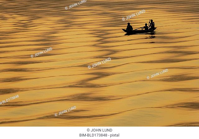 Silhouette of people on fishing boat
